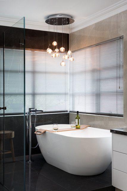soak-tub-large-grey-tiles-suspension-lighting
