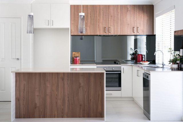 open-plan-kitchen-white-timber-pendant-lighting