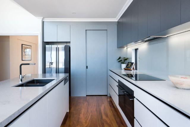 front-view-walkin-pantry-black-appliances