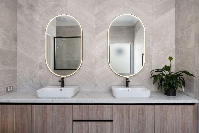 chevron-tiling-double-vanity-oval-mirrors